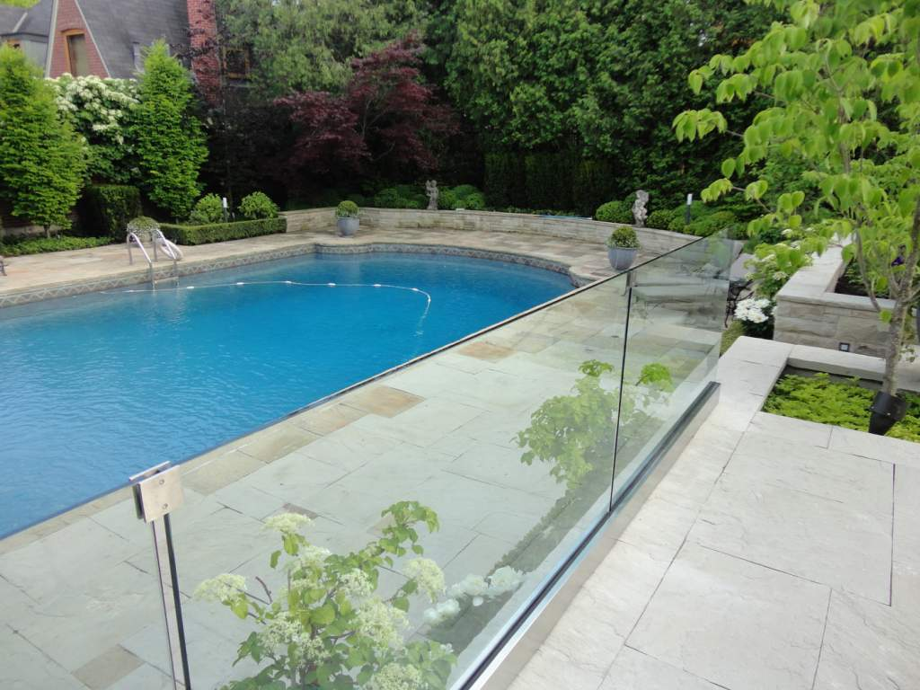 outdoor glass railings near a pool