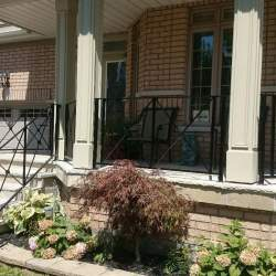 front porch staircase with exterior railings