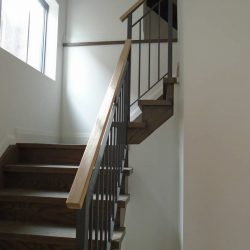 Wooden stairs and steel railings