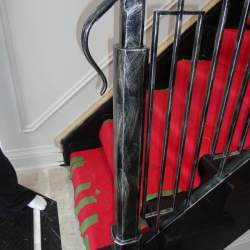 Photo of Stairs with red carpet