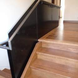 Photo of Wood Stairs and glass railings