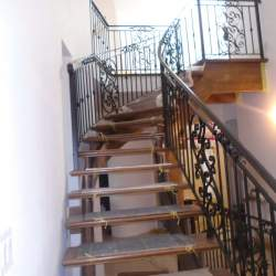 Photo of Wooden Stairs with Metal Railings