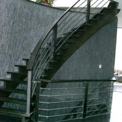 outdoor round staircase with steel railings