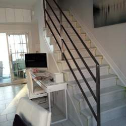 Photo of Stairs with metal railings