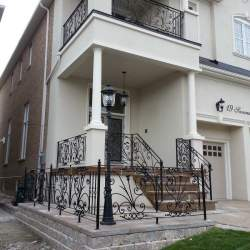 white porch with black steel railings