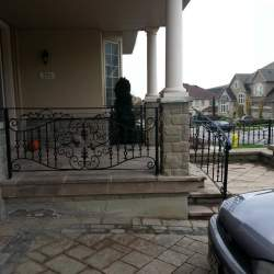front porch near driveway outdoor railings