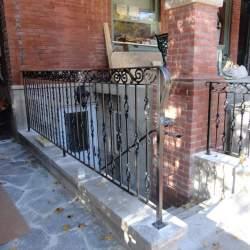 backyard staircase with railings to basement