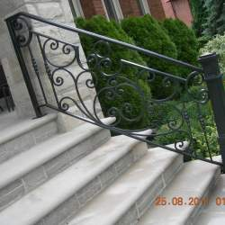 concrete stairs with steel railings