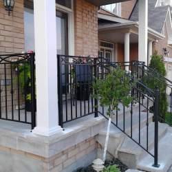 steel railings on concrete stairs