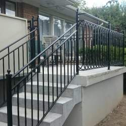 exterior staircase with steel railings