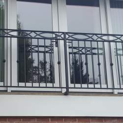 second floor window with Wrought iron railings