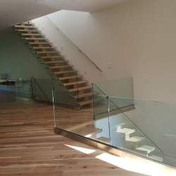indoor staircase with glass railings
