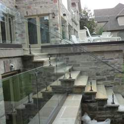 outdoor staircase with frameless glass railings