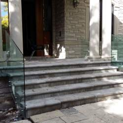 front porch staircase with frameless glass railings