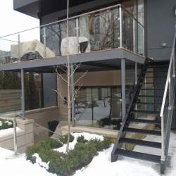 first and second floor with stainless steel railings